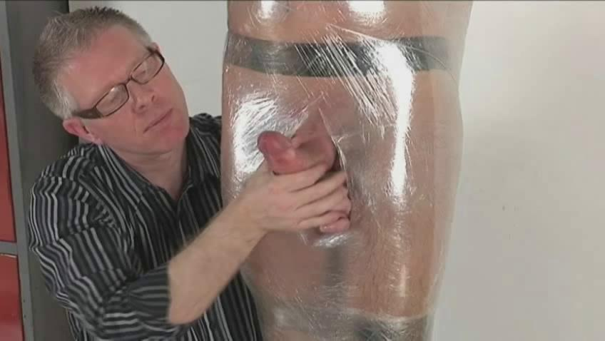 Homosexual boyfrend with hard dick receives fastened and wrapped like a mummy