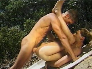 Angry sex jocks engulfing each others hard ramrods whilst on a picnic in...