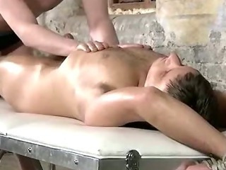 Bound up fellow getting his cock sucked and tugged