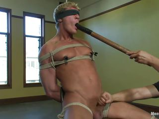 Gavin has a hawt muscled body and he's fastened real hard on that chair so that guy wouldn't be able to oppose his treatment. His body is tense as the executor puts clamps on his teats and taunts him by fucking his nice-looking face hole with a large sextoy then excites his wang with a vibrator. After that guy warmed him up that guy gives a admirable tugjob and proceeds to fuck that cum asking face hole with the sex toy.