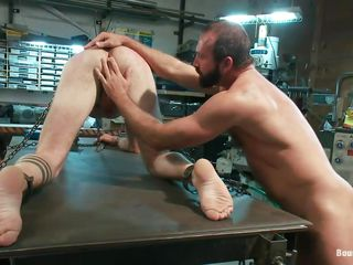 Look at that sexy body, this guy is just asking for a hard fuck from behind and the chap is ready to give all this guy needs and more. After tieing him on the workbench this guy uses a sextoy attached at a tool and really drills his ass in advance of ridding it, inserting all his 10-Pounder unfathomable in his rectum. Although he's tied, I wager this guy enjoys the coarse fuck