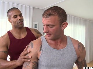 Great massage chap is showing his skills to that tattooed bodyguard