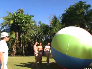 Great team work with four nice muscular fellows and giant ball, have a fun