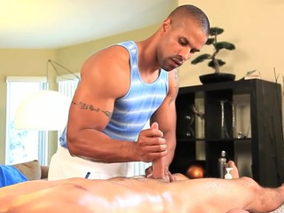 Gay masseur is giving man a wild oral stimulation session